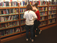 Girls Choosing Titles from the Stacks
